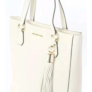 New with tags, never used Michael Kors Cream Purse